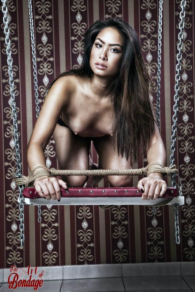 Asian beauty tied on a swing