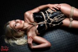 Tied blonde lying on floor - Fine Art of Bondage